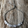 Silver strand Bracelet – adjustable sliding clasp with nine Cubic Zirconia Stones – Nadra