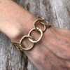 Matt gold T bar Bracelet with linked connecting circles – Jalen G