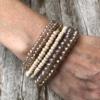 Set of six Bracelets with matt gold, wood and glass beads – Jaxi