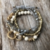 Set of four Bracelets with matt gold and natural howlite beads – Jenis