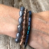 Three Bracelets with blue and champagne gold beads – Yori B03-08-09