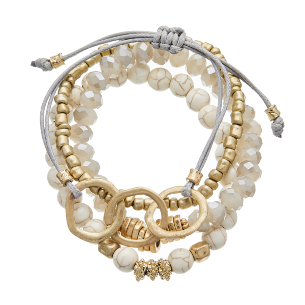 Set of four Bracelets with matt gold and natural howlite beads - Jenis